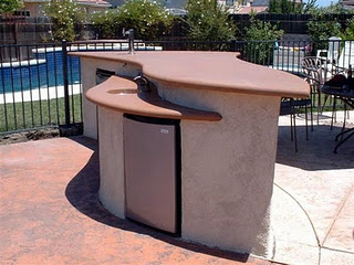 custom BBQ entertainment island with concrete countertop